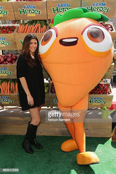 Jamie Lynn Sigler poses with Farm Heroes Sage 'Cropsies' as they honor the launch of new mobile game Farm Heroes Saga with an ode to urban farming at...