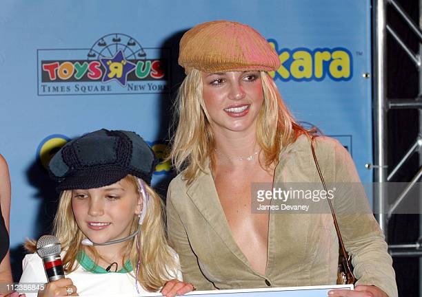 Jamie Lynn Spears and Britney Spears during Jamie Lynn Spears Takes Center Stage with Hasbro's ekara Real Karaoke PRO Headset at Toys R Us Times...