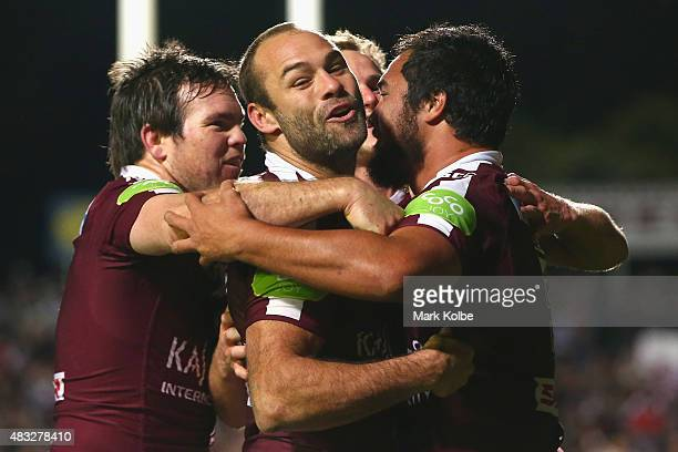 Jamie Lyon Brett Stewart and Daly CherryEvans of the Eagles celebrate with Peter Hiku of the Eagles after he scored a try during the round 22 NRL...
