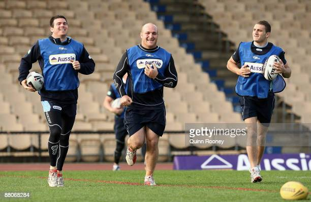 Jamie Lyon Michael Weyman and Robbie Farah of the Blues warm up during a New South Wales State of Origin training session at Olympic Park on May 30...