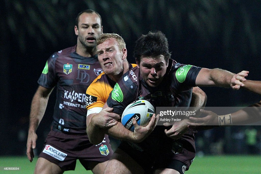 Jamie Lyon of Manly is tackled by Jack Reed of the Broncos during the round 21 NRL match between the Manly Sea Eagles and the Brisbane Broncos at Central Coast Stadium on August 1, 2015 in Gosford, Australia.