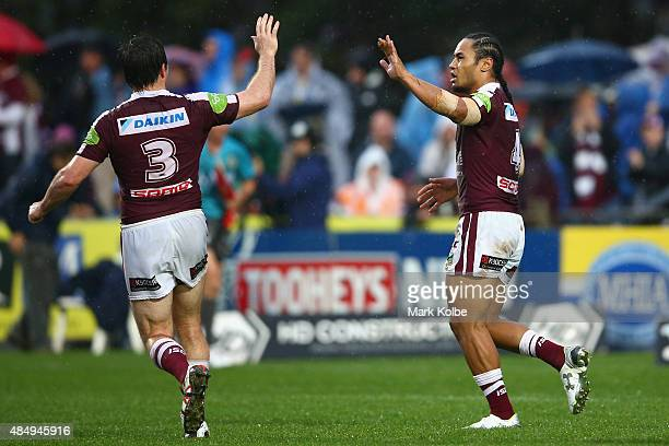 Jamie Lyon of the Eagles celebrates with Steve Matai of the Eagles after he scored a try during the round 24 NRL match between the Manly Warringah...