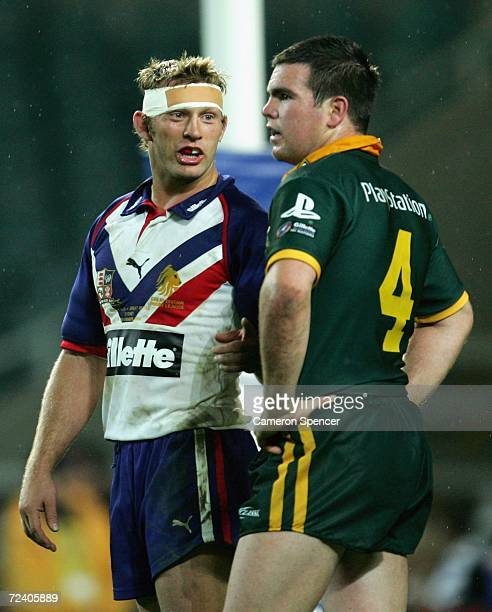 Jamie Lyon of the Kangaroos talks to Sean Long of the Lions during the Tri-Nations Series match between the Australian Kangaroos and the Great...