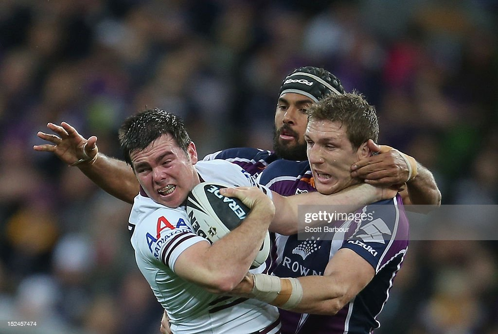 Jamie Lyon of the Sea Eagles is tackled during the NRL Preliminary Final match between the Melbourne Storm and the Manly Sea Eagles at AAMI Park on September 21, 2012 in Melbourne, Australia.