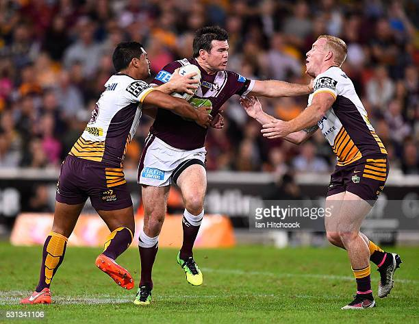 Jamie Lyon of the Sea Eagles looks to get past Anthony Milford and Jack Reed of the Broncos during the round 10 NRL match between the Manly Sea...