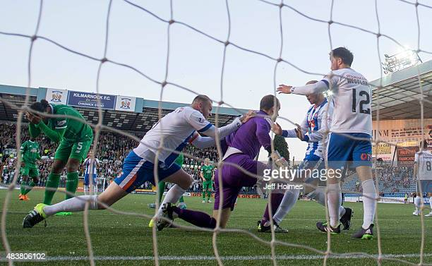 Jamie Macdonald Kilmarnock is congratulated by team mates after pulling off brillant save in action during the Scottish premiership match between...
