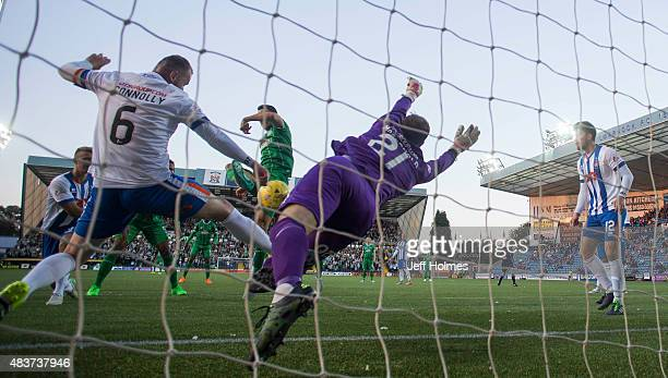 Jamie Macdonald of Kilmarnock maves a save during the Scottish premiership match between Kilmarnock and Celtic at Rugby Park on August 12 2015 in...