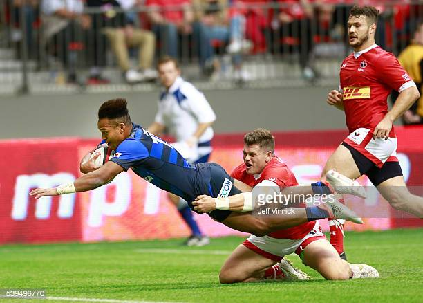Jamie Mackenzie of Canada tries to tackle Kotaro Matsushima of Japan as he scores the winning try during their match at BC Place on June 11 2016 in...