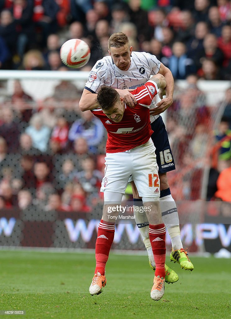Jamie Mackie of Nottingham Forest challened for the ball by Mark Beevers of Millwall during the Sky Bet Championship match between Nottingham Forest and Millwall at City Ground on April 05, 2014 in Nottingham, England,