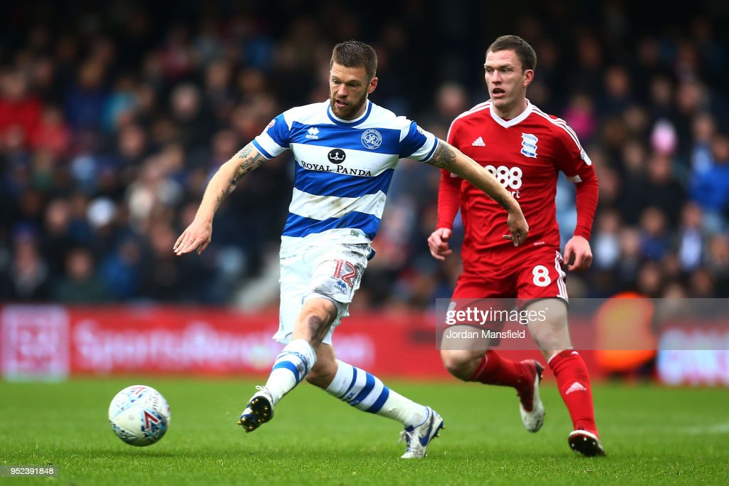 Jamie Mackie of QPR tackles with Craig Gardener of Birmingham during the Sky Bet Championship match between Queens Park Rangers and Birmingham City at Loftus Road on April 28, 2018 in London, England.