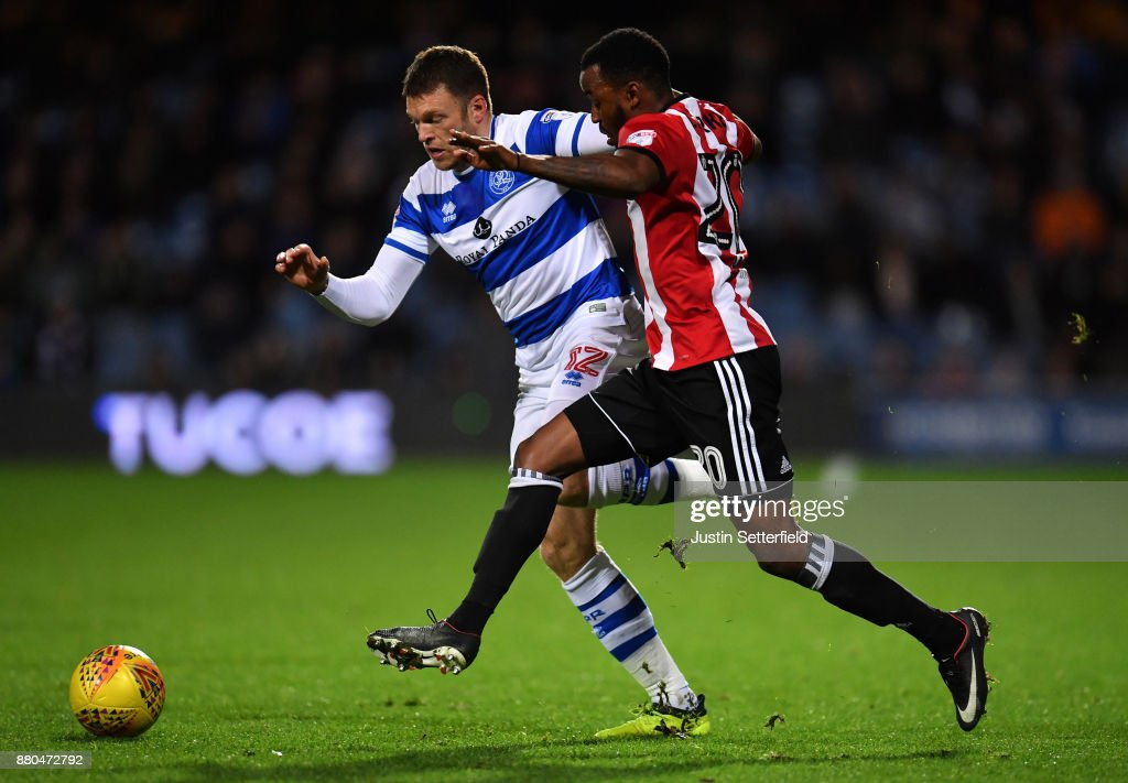 Jamie Mackie of Queens Park Rangers and Josh Clarke of Brentford in action during the Sky Bet Championship match between Queens Park Rangers and Brentford at Loftus Road on November 27, 2017 in London, England.