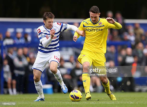 Jamie Mackie of Queens Park Rangers challenges Sean Morrison of Reading during the Barclays Premier League match between Queens Park Rangers and...
