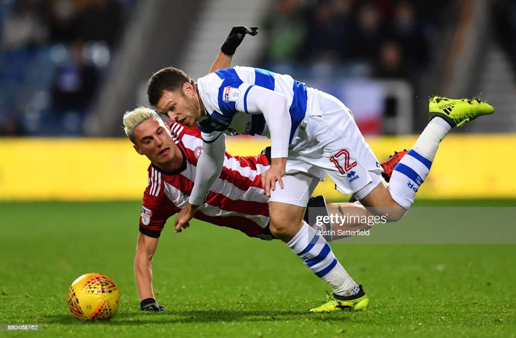 Jamie Mackie of Queens Park Rangers is challenged by Sergi Canos of Brentford during the Sky Bet Championship match between Queens Park Rangers and Brentford at Loftus Road on November 27, 2017 in London, England.