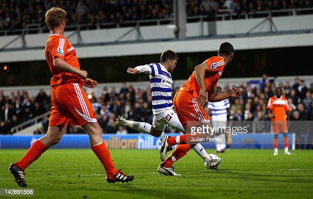 Jamie Mackie of Queens Park Rangers scores his side's second goal during the Barclays Premier League match between Queens Park Rangers and Swansea...