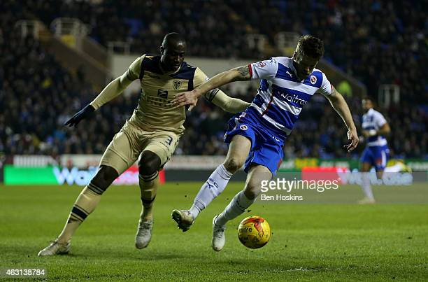 Jamie Mackie of Reading holds off the challenge of Sol Bamba of Leeds during the Sky Bet Championship match between Reading and Leeds United at...