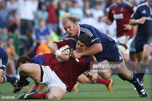 Jamie Mackintosh from the Highlanders being tackled by Schalk Burger from the Stormers during the Super 14 match between Stormers v Highlanders at...