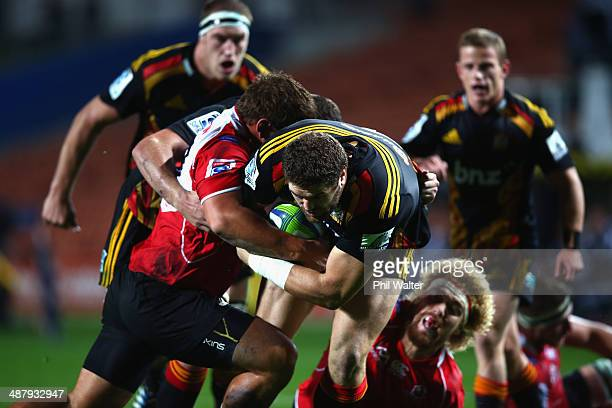 Jamie Mackintosh of the Chiefs drives the ball forward during the round 12 Super Rugby match between the Chiefs and the Lions at Waikato Stadium on...