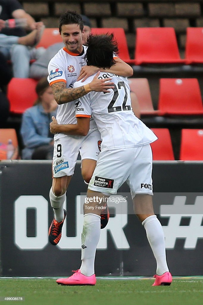 Jamie Maclaren and Thomas Broich of the Roar celebrate a goal during the round eight A-League match between the Newcastle Jets and Brisbane Roar at Hunter Stadium on November 28, 2015 in Newcastle, Australia.