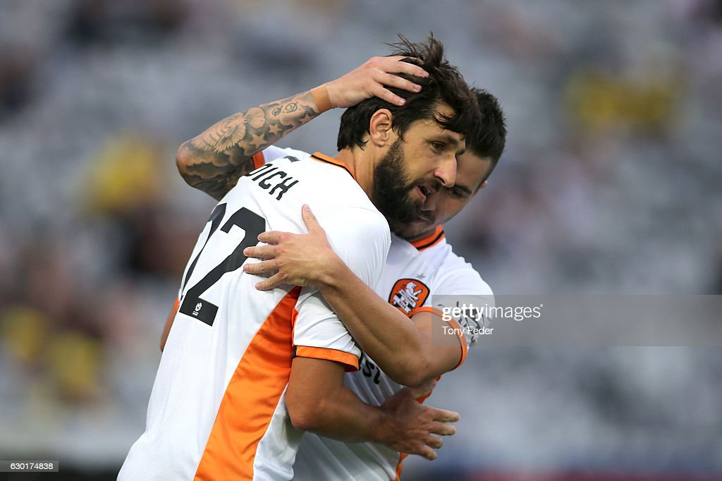 Jamie Maclaren and Thomas Broich of the Roar celebrate a goal during the round 11 A-League match between the Central Coast Mariners and Brisbane Roar at Central Coast Stadium on December 18, 2016 in Gosford, Australia.