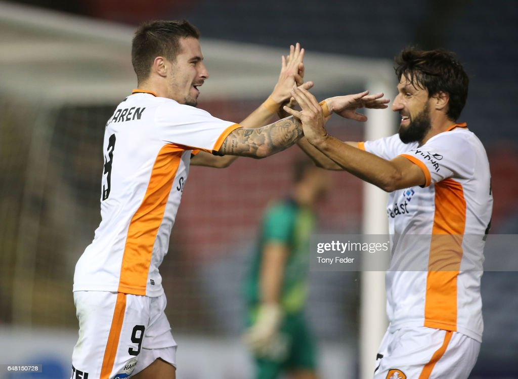 Jamie Maclaren and Thomas Broich of the Roar celebrate a goal during the round 22 A-League match between the Newcastle Jets and the Brisbane Roar at McDonald Jones Stadium on March 5, 2017 in Newcastle, Australia.