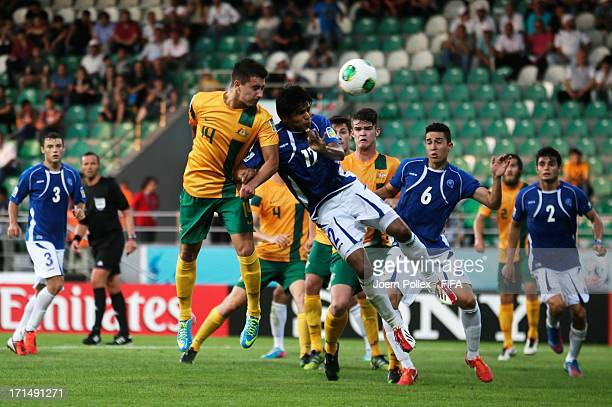 Jamie Maclaren of Australia and Kevin Barahona of El Salvador compete for the ball during the FIFA U20 World Cup Group C match between Australia and...