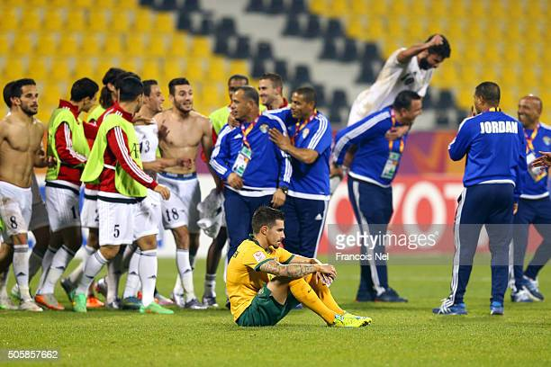 Jamie Maclaren of Australia shows his dejection as he sits on the turf after the AFC U23 Championship Group D match between Jordan and Australia at...