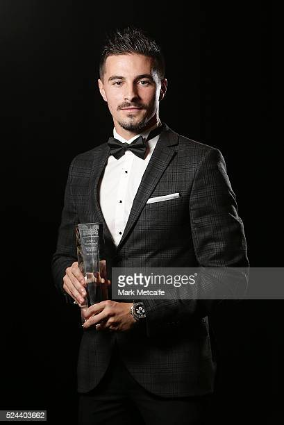 Jamie Maclaren of Brisbane Roar poses with the NAB Young Footballer of the Year Award during the 2016 FFA Dolan Warren Awards at Carriageworks on...