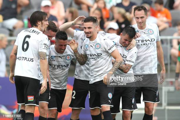 Jamie Maclaren of Melbourne City celebrates a hat trick with team mates during the round six ALeague match between Brisbane Roar and Melbourne City...