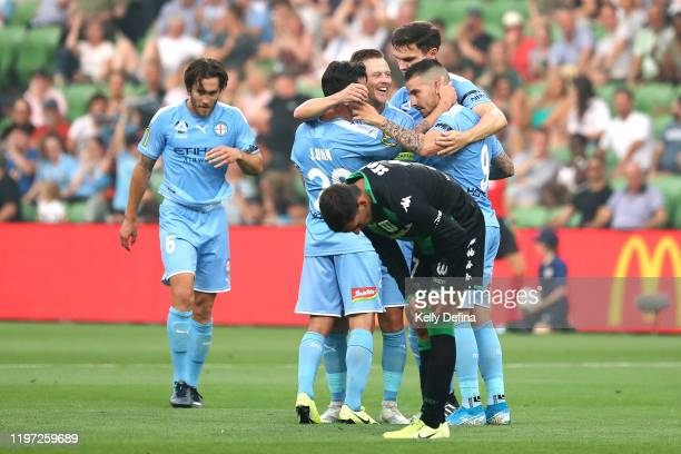 Jamie Maclaren of Melbourne City celebrates his goal with Scott Jamieson of Melbourne City and team mates during the round 13 ALeague match between...