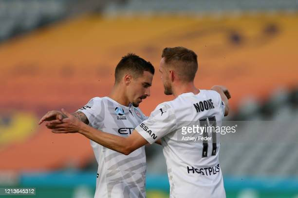 Jamie Maclaren of Melbourne City celebrates his goal with team mate Craig Noone during the round 24 ALeague match between the Central Coast Mariners...