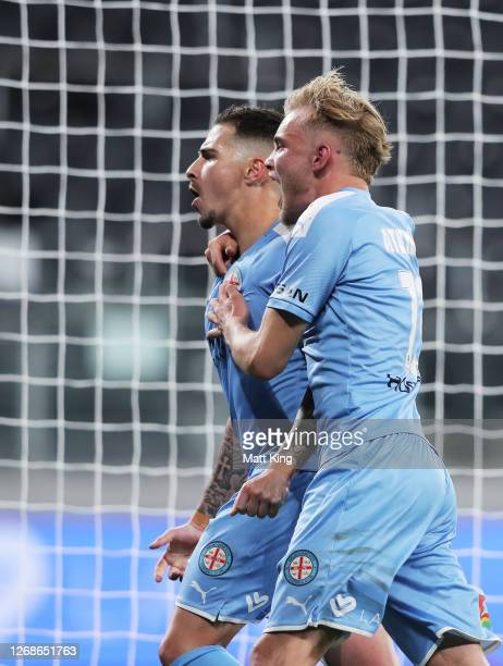 Jamie Maclaren of Melbourne City celebrates with Nathaniel Atkinson after scoring a goal during the A-League Semi Final match between Melbourne City...