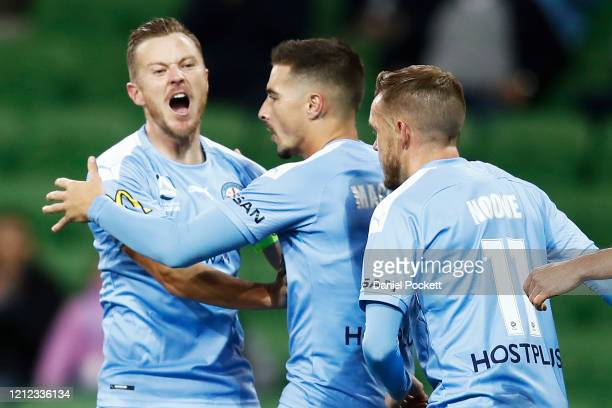 Jamie Maclaren of Melbourne City celebrates with Scott Jamieson and Craig Noone of Melbourne City after kicking a penalty goal during the round 23...