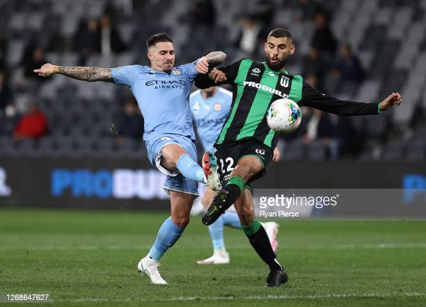 Jamie Maclaren of Melbourne City competes for the ball against Tomislav Uskok of Western United during the ALeague Semi Final match between Melbourne...