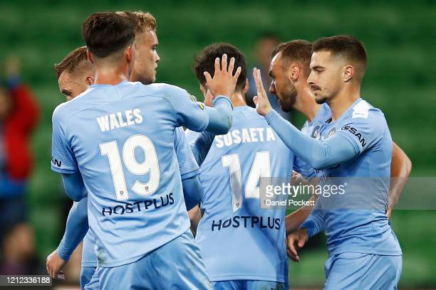 Jamie Maclaren of Melbourne City high fives teammates after kicking a penalty goal during the round 23 ALeague match between Melbourne City and the...