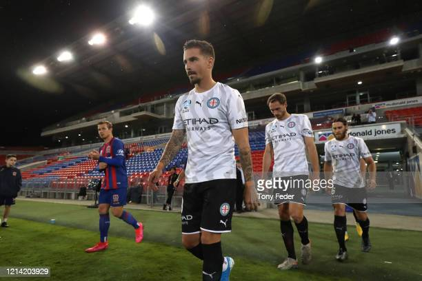 Jamie Maclaren of Melbourne City walks out to start the game during the round 26 ALeague match between the Newcastle Jets and Melbourne City at...