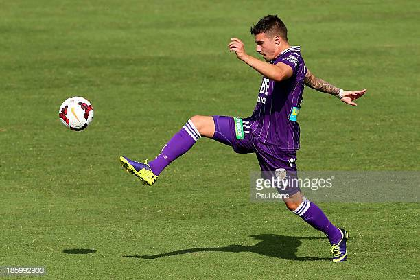Jamie MacLaren of the Glory traps the ball during the round three ALeague match between Perth Glory and the Melbourne Heart at nib Stadium on October...