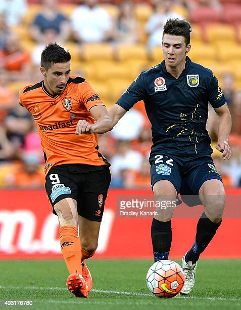 Jamie Maclaren of the Roar and Jake McGing of the Mariners compete for the ball during the round two ALeague match between the Brisbane Roar and...