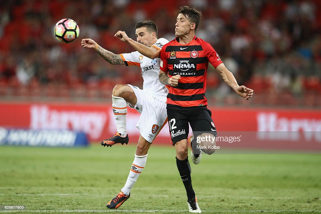 Jamie Maclaren of the Roar and Scott Neville of the Wanderers compete for the ball during the round eight A-League match between the Western Sydney Wanderers and the Brisbane Roar at Spotless Stadium on November 25, 2016 in Sydney, Australia.