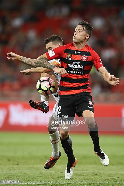 Jamie Maclaren of the Roar and Scott Neville of the Wanderers compete for the ball during the round eight ALeague match between the Western Sydney...