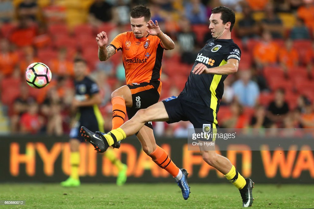 Jamie Maclaren of the Roar and Storm Roux of the Mariners compete for the ball during the round 25 A-League match between the Brisbane Roar and the Central Coast Mariners at Suncorp Stadium on April 2, 2017 in Brisbane, Australia.