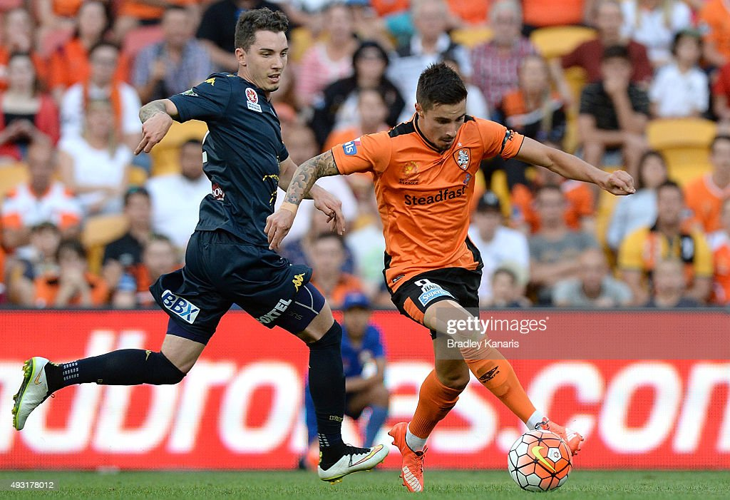 Jamie Maclaren of the Roar attempts to break away from the defence during the round two A-League match between the Brisbane Roar and Central Coast Mariners at Suncorp Stadium on October 18, 2015 in Brisbane, Australia.