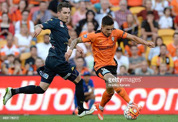 Jamie Maclaren of the Roar attempts to break away from the defence during the round two ALeague match between the Brisbane Roar and Central Coast...