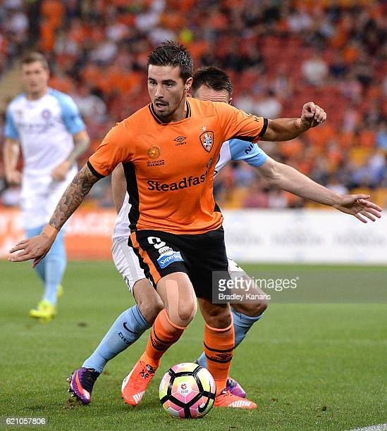 Jamie Maclaren of the Roar attempts to break away from the defence during the round five ALeague match between the Brisbane Roar and Melbourne City...