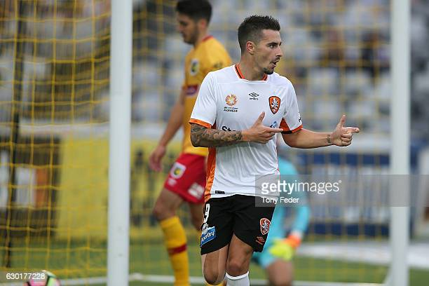 Jamie Maclaren of the Roar celebrates scoring a goal during the round 11 ALeague match between the Central Coast Mariners and Brisbane Roar at...