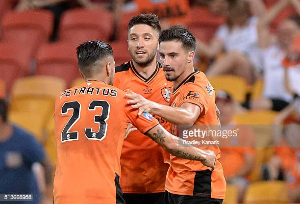 Jamie Maclaren of the Roar celebrates scoring a goal with his team mates during the round 22 ALeague match between the Brisbane Roar and the Western...