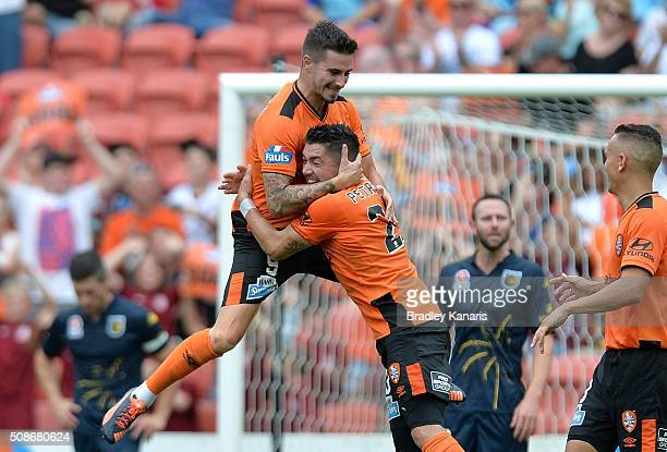 Jamie Maclaren of the Roar celebrates with team mate Dimitri Petratos after scoring a goal during the round 18 A-League match between the Brisbane...