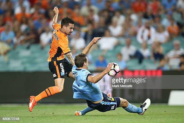Jamie Maclaren of the Roar has a shot blocked by Alex Wilkinson of Sydney FC during the round 13 ALeague match between Sydney FC and Brisbane Roar at...