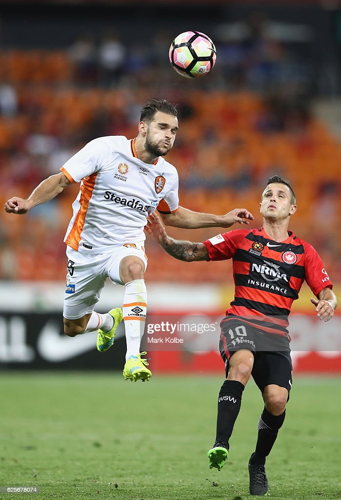 Jamie Maclaren of the Roar heads the ball over Nicolas Martnez of the Wanderers during the round eight A-League match between the Western Sydney Wanderers and the Brisbane Roar at Spotless Stadium on November 25, 2016 in Sydney, Australia.
