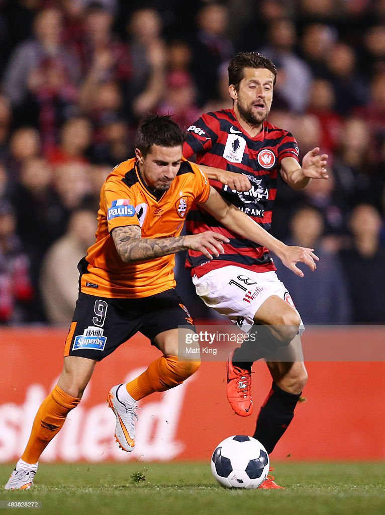 Jamie Maclaren of the Roar is challenged by Andreu Guerao of the Wanderers during the FFA Cup match between Western Sydney Wanderers and Brisbane Roar at Pepper Stadium on August 11, 2015 in Sydney, Australia.