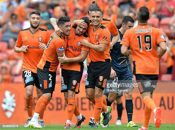 Jamie Maclaren of the Roar is congratulated by team mates after scoring a goal during the round 18 ALeague match between the Brisbane Roar and...